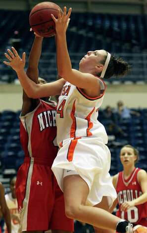Roadrunners center Lyndi Thorman puts up a shot against Nicholls' Jasmine Hoskins as the UTSA women play Nicholls at the UTSA Convocation Center on Saturday, Feb. 19, 2011. Photo: TOM REEL, SAN ANTONIO EXPRESS-NEWS / © 2011 San Antonio Express-News
