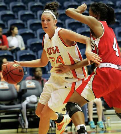 Roadrunners center Lyndi Thorman looks for room around Nicholls' Jasmine Hoskins. Thorman had 12 points and 10 rebounds as UTSA edged Nicholls State at the UTSA Convocation Center on Saturday, Feb. 19, 2011. Photo: TOM REEL, SAN ANTONIO EXPRESS-NEWS / © 2011 San Antonio Express-News