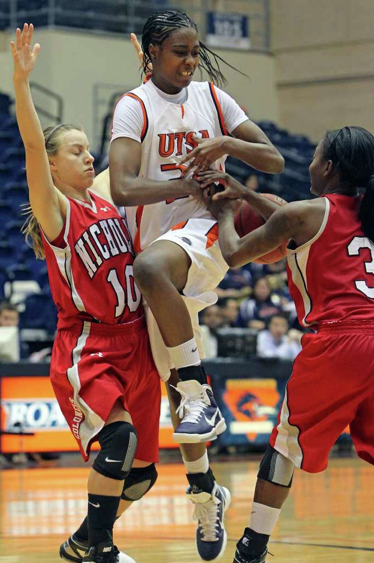 Ashley Gardner is stripped of the ball in the final moments of regulation by Nicholls player Ricshanda Bickman (3) and K.K. Babin as the UTSA women play Nicholls at the UTSA Convocation Center on Saturday, Feb. 19, 2011.