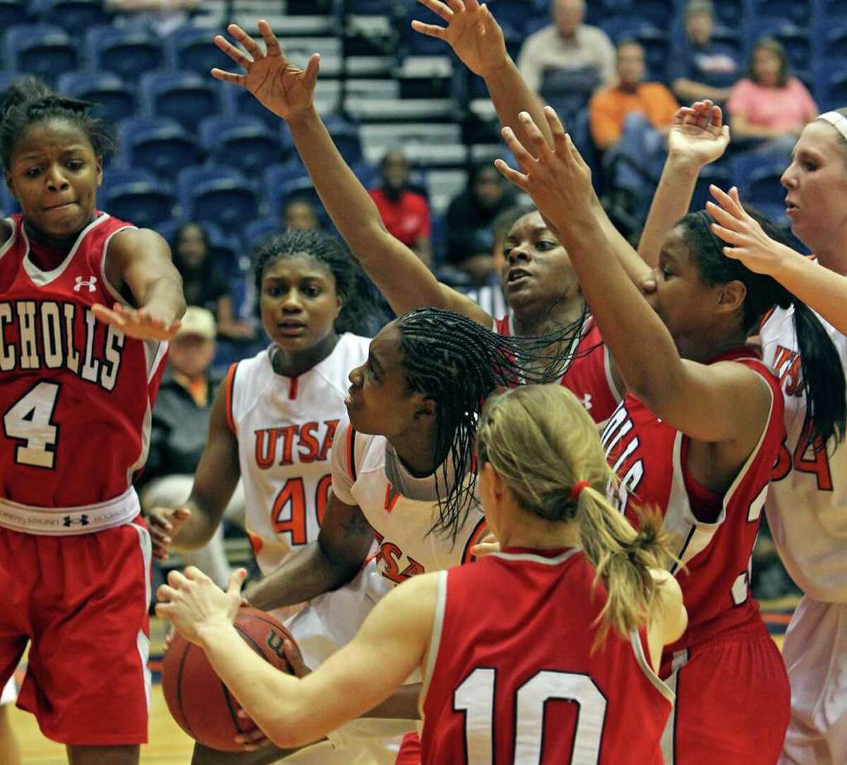 Roadrunners forward Ashley Gardner takes a rebound and gets a shot at winning the game in regulation as the UTSA women play Nicholls at the UTSA Convocation Center on Saturday, Feb. 19, 2011.