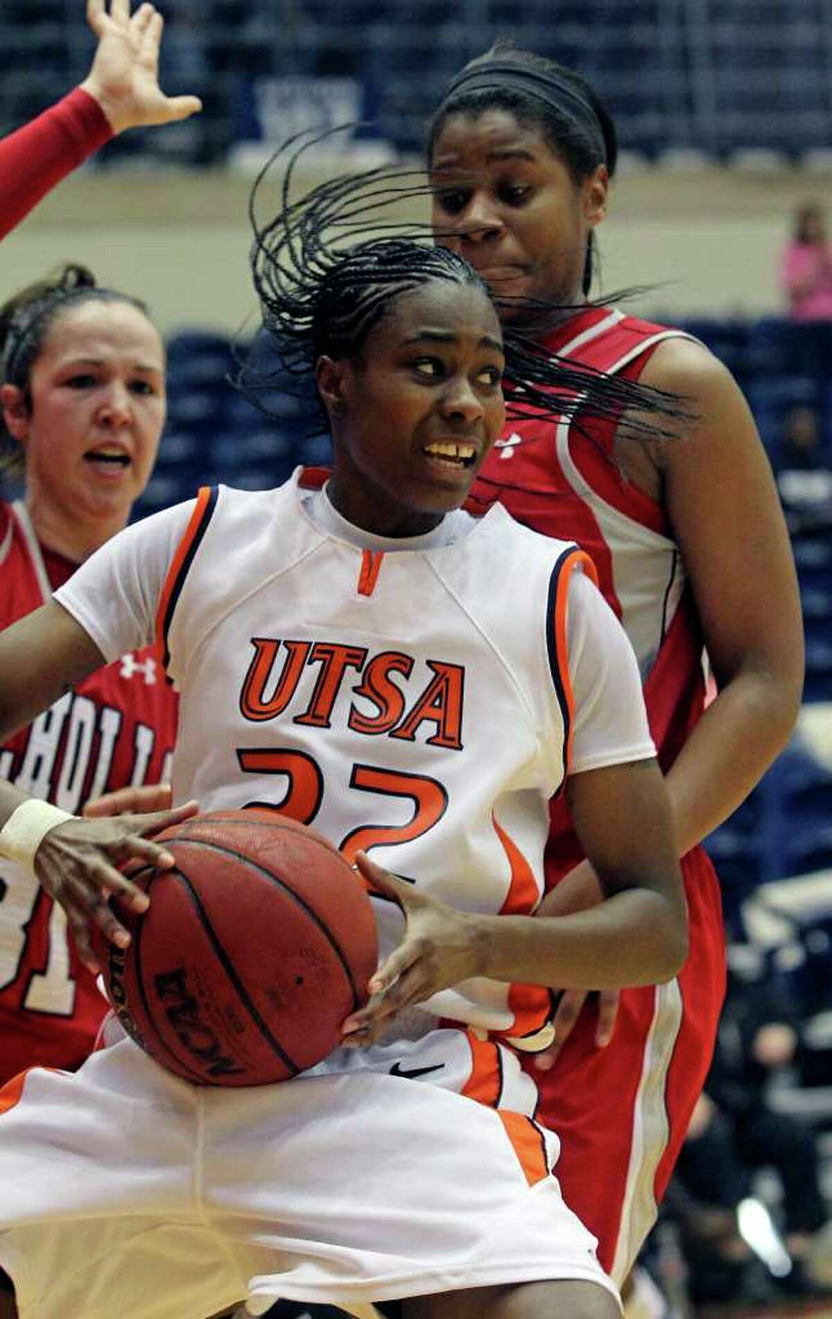 Roadrunners forward Ashley Gardner pivots under the hoop as the UTSA women play Nicholls at the UTSA Convocation Center on Saturday, Feb. 19, 2011.