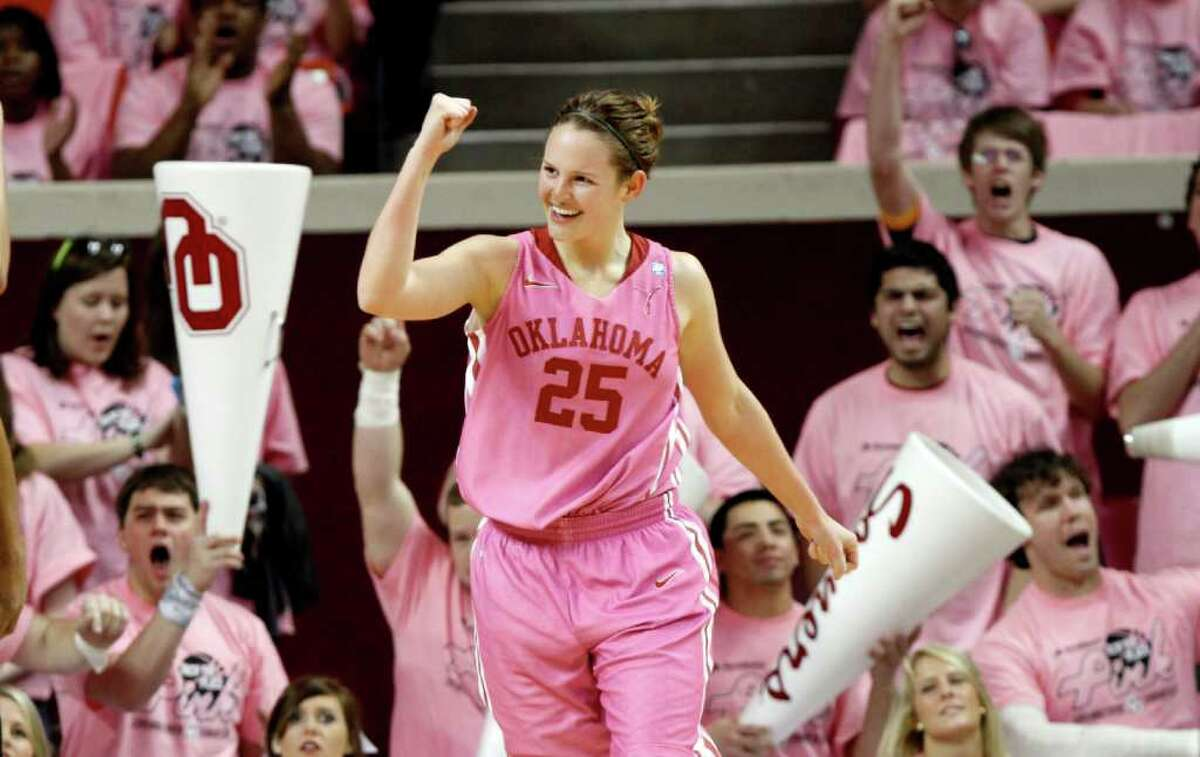 Oklahoma's Whitney Hand celebrates during the game against Texas in Norman, Okla., on Saturday, Feb. 19, 2011.