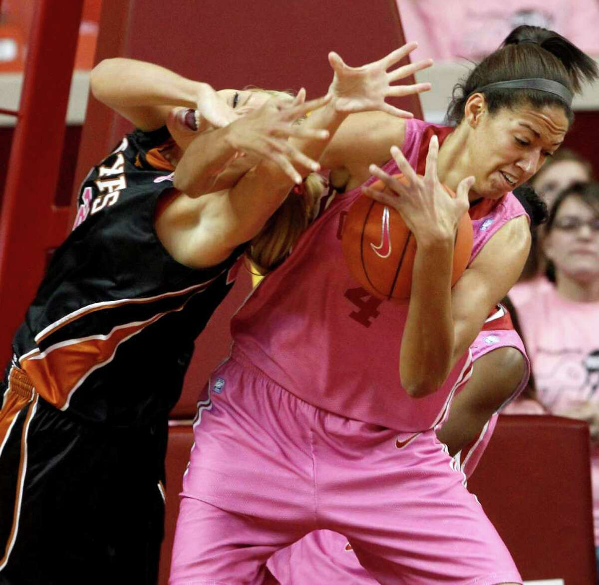 Oklahoma's Nicole Griffin fights with Texas' Kristen Nash for the ball in Norman, Okla., on Saturday, Feb. 19, 2011.