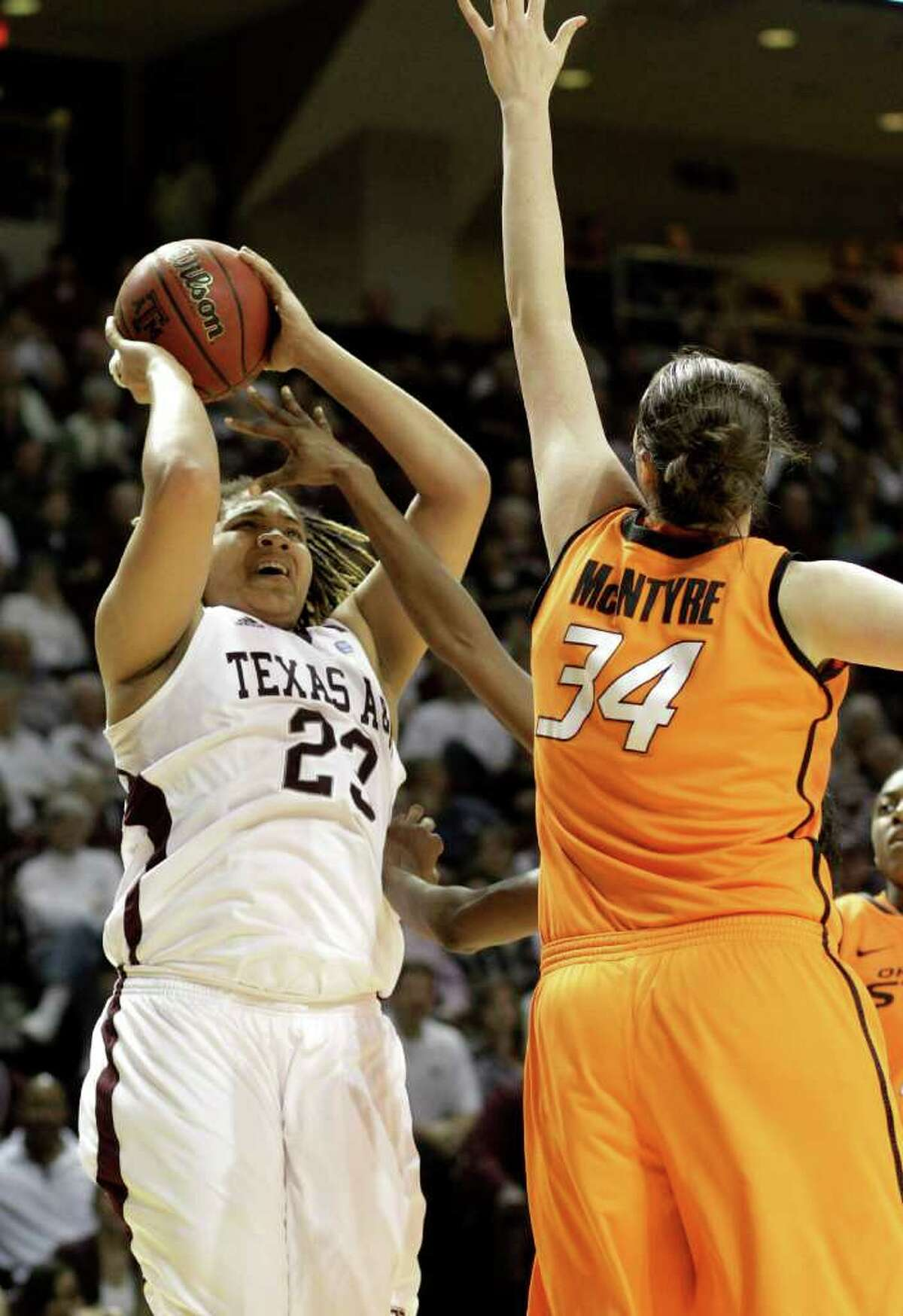 Texas A&M's Danielle Adams shoots over Oklahoma State's Vicky McIntyre during the first half on Saturday, Feb. 19, 2011, in College Station.