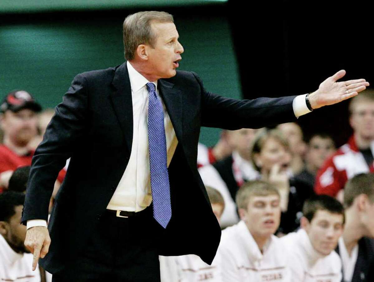 Texas coach Rick Barnes instructs his players against Nebraksa during the first half in Lincoln, Neb., on Saturday, Feb. 19, 2011.