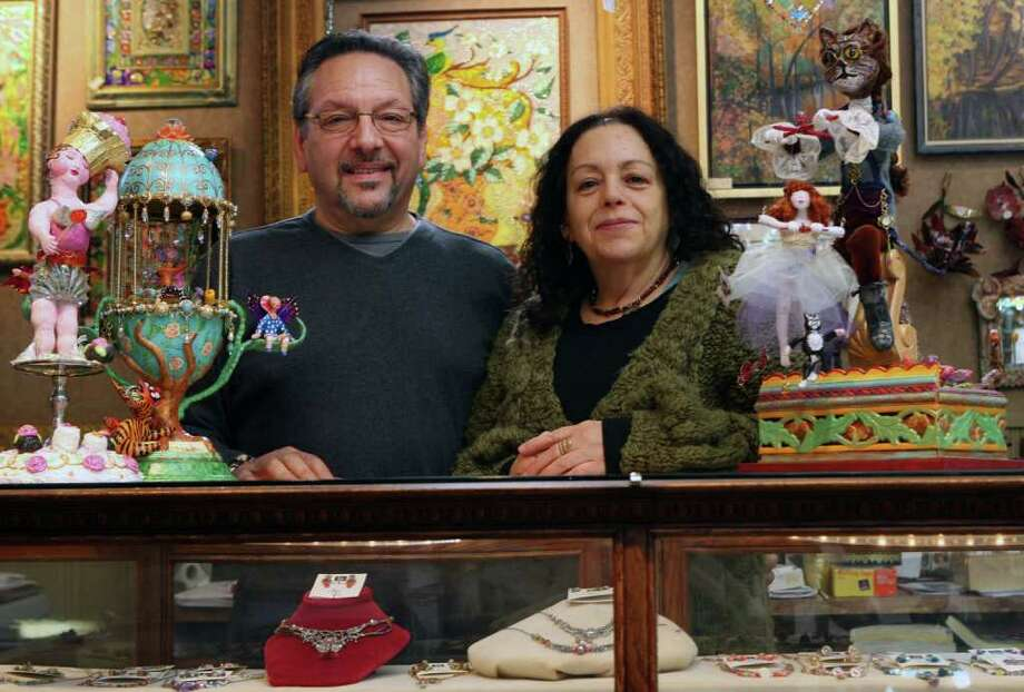 Barry Gordon and Rosemary Celon-Gordon own the Gilded Lily, a multimedia gallery , in Milford. Over 30 local artists are represented, as well as Celon-Gordon's sculptures, right and left, and her paintings on glass, back. Photographer Gordon also has his work  on display. The gallery also sells handmade glass and jewelry.  Feb. 20, 2011 Photo: B.K. Angeletti / Connecticut Post