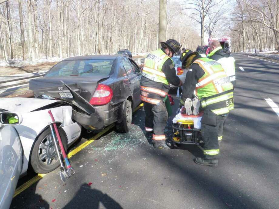A person injured in a four-car crash on the Merritt Parkway in Westport Sunday afternoon is prepared for trasnit to Norwalk Hospital for treatment. Photo: Contributed Photo/Westport Fire Department / Westport News contributed