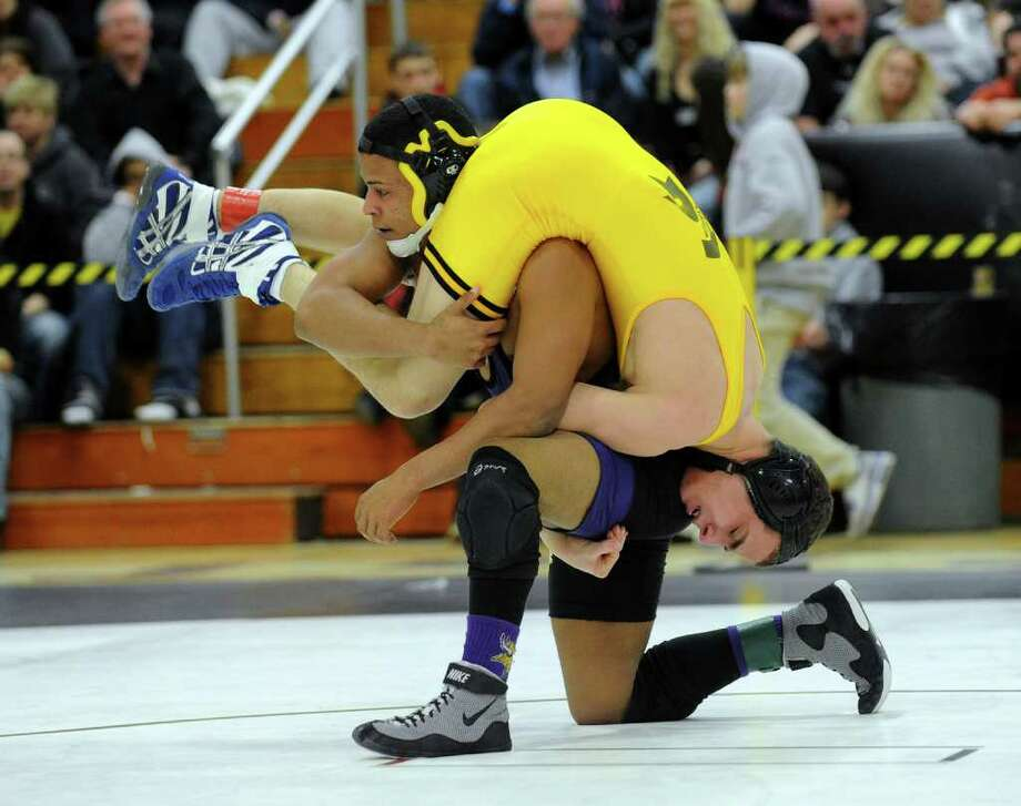 Amity's Tyler Bishop dangles on the shoudlers of Westhill's Chris Chaparro, during CIAC Class LL Wrestling Tournament in Trumbull, Conn. on Saturday February 19, 2011. Photo: Christian Abraham / Connecticut Post