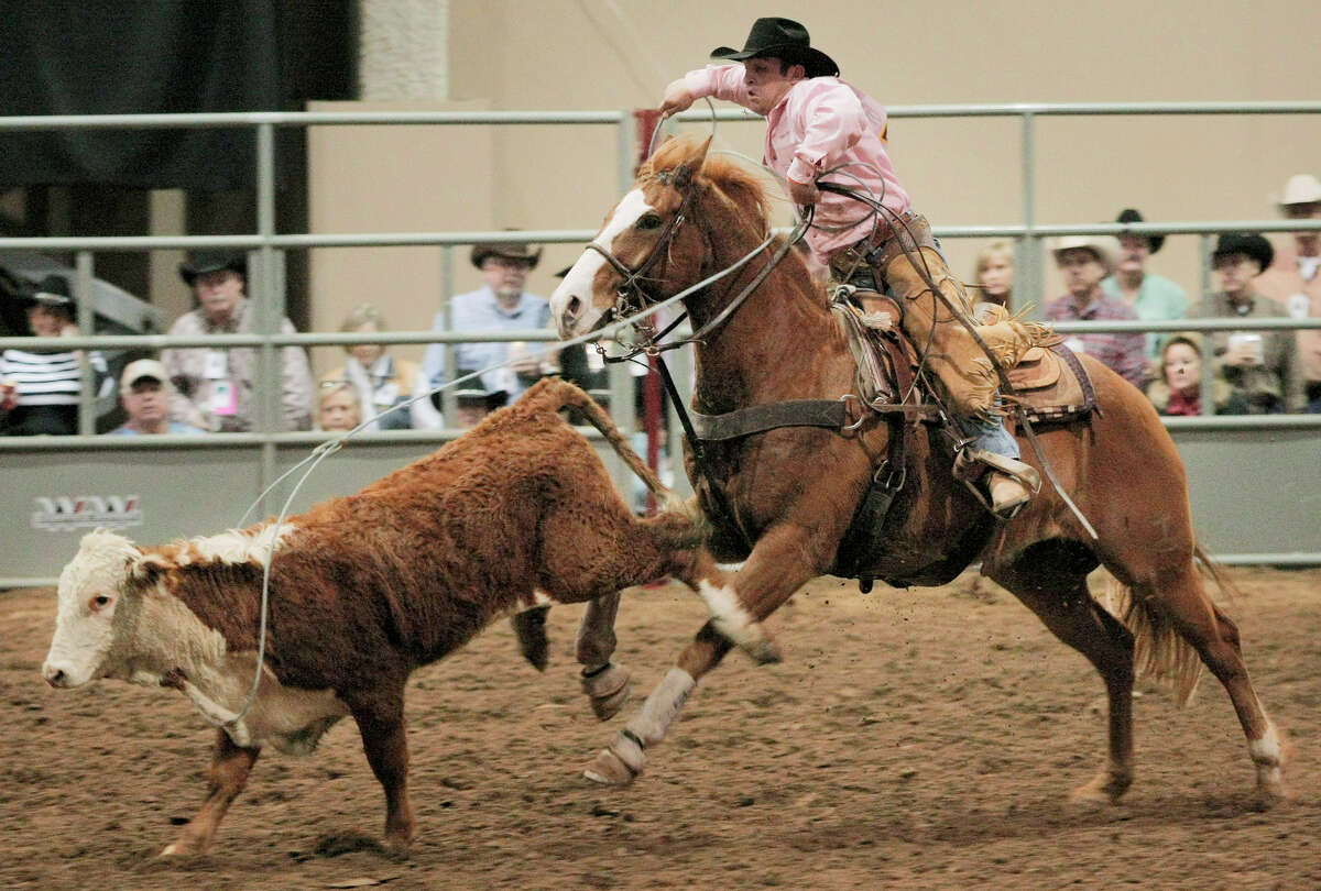 Solomon Land and Cattle team member Dillon Shults ropes a calf during the ranch rodeo, on the last day of the San Antonio Stock Show and Rodeo, Sunday, Feb. 20, 2011, in San Antonio.