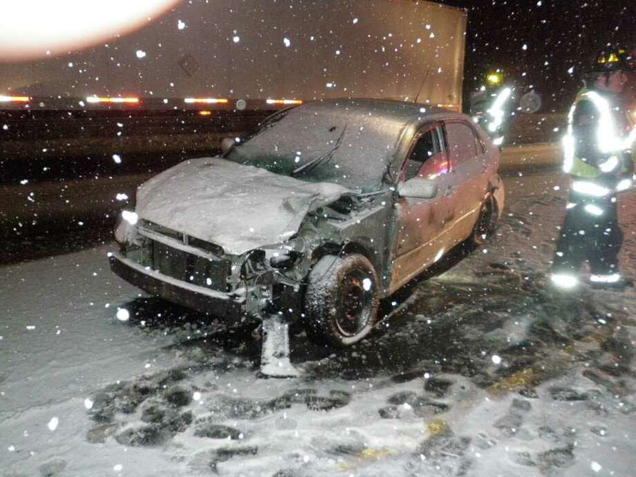 A 5-year-old child suffered a head injury when a tractor-trailer and a car driven by his mother collided on Interstate 95 in Westport as snow began falling early Monday. Photo: Contributed Photo/Westport Fire Department / Westport News contributed