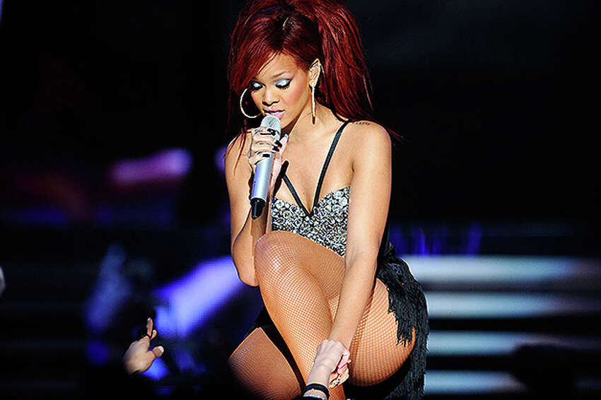 LOS ANGELES, CA - FEBRUARY 20: Singer Rihanna performs during the 2011 NBA All-Star game halftime show at Staples Center on February 20, 2011 in Los Angeles, California. NOTE TO USER: User expressly acknowledges and agrees that, by downloading and or using this photograph, User is consenting to the terms and conditions of the Getty Images License Agreement. (Photo by Kevork Djansezian/Getty Images) *** Local Caption *** Rihanna