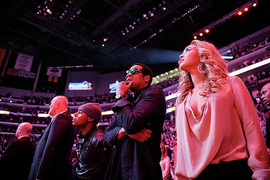 LOS ANGELES, CA - FEBRUARY 20:  Rapper Jay-Z (C) and singer Beyonce Knowles (R) stand for the National Anthem during the 2011 NBA All-Star game at Staples Center on February 20, 2011 in Los Angeles, California. NOTE TO USER: User expressly acknowledges and agrees that, by downloading and or using this photograph, User is consenting to the terms and conditions of the Getty Images License Agreement.  (Photo by Kevork Djansezian/Getty Images) *** Local Caption *** Jay-Z;Beyonce Knowles Photo: Kevork Djansezian, Getty Images / 2011 Getty Images