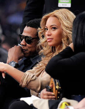 LOS ANGELES, CA - FEBRUARY 20:  Rapper Jay-Z (L) and singer Beyonce Knowles sit in the audience during the 2011 NBA All-Star game at Staples Center on February 20, 2011 in Los Angeles, California. NOTE TO USER: User expressly acknowledges and agrees that, by downloading and or using this photograph, User is consenting to the terms and conditions of the Getty Images License Agreement.  (Photo by Kevork Djansezian/Getty Images) *** Local Caption *** Jay-Z;Beyonce Knowles Photo: Kevork Djansezian, Getty Images / 2011 Getty Images