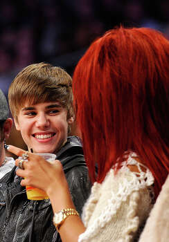 LOS ANGELES, CA - FEBRUARY 20:  Singers Justin Bieber (L) and Rihanna talk in the audience during the 2011 NBA All-Star game at Staples Center on February 20, 2011 in Los Angeles, California. NOTE TO USER: User expressly acknowledges and agrees that, by downloading and or using this photograph, User is consenting to the terms and conditions of the Getty Images License Agreement.  (Photo by Kevork Djansezian/Getty Images) *** Local Caption *** Justin Bieber;Rihanna Photo: Kevork Djansezian, Getty Images / 2011 Getty Images