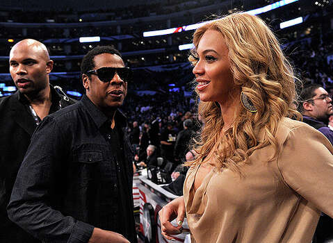LOS ANGELES, CA - FEBRUARY 20:  Jay-Z (L) and singer Beyonce Knowles speak during the 2011 NBA All-Star game at Staples Center on February 20, 2011 in Los Angeles, California. NOTE TO USER: User expressly acknowledges and agrees that, by downloading and or using this photograph, User is consenting to the terms and conditions of the Getty Images License Agreement.  (Photo by Kevork Djansezian/Getty Images) *** Local Caption *** Jay-Z;Beyonce Knowles Photo: Kevork Djansezian, Getty Images / 2011 Getty Images