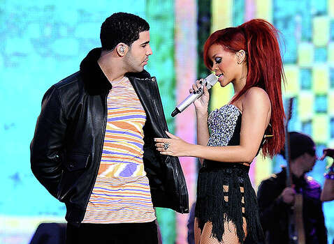 LOS ANGELES, CA - FEBRUARY 20:  Rapper Drake (L) and singer Rihanna perform during the 2011 NBA All-Star game halftime show at Staples Center on February 20, 2011 in Los Angeles, California. NOTE TO USER: User expressly acknowledges and agrees that, by downloading and or using this photograph, User is consenting to the terms and conditions of the Getty Images License Agreement.  (Photo by Kevork Djansezian/Getty Images) *** Local Caption *** Drake;Rihanna Photo: Kevork Djansezian, Getty Images / 2011 Getty Images