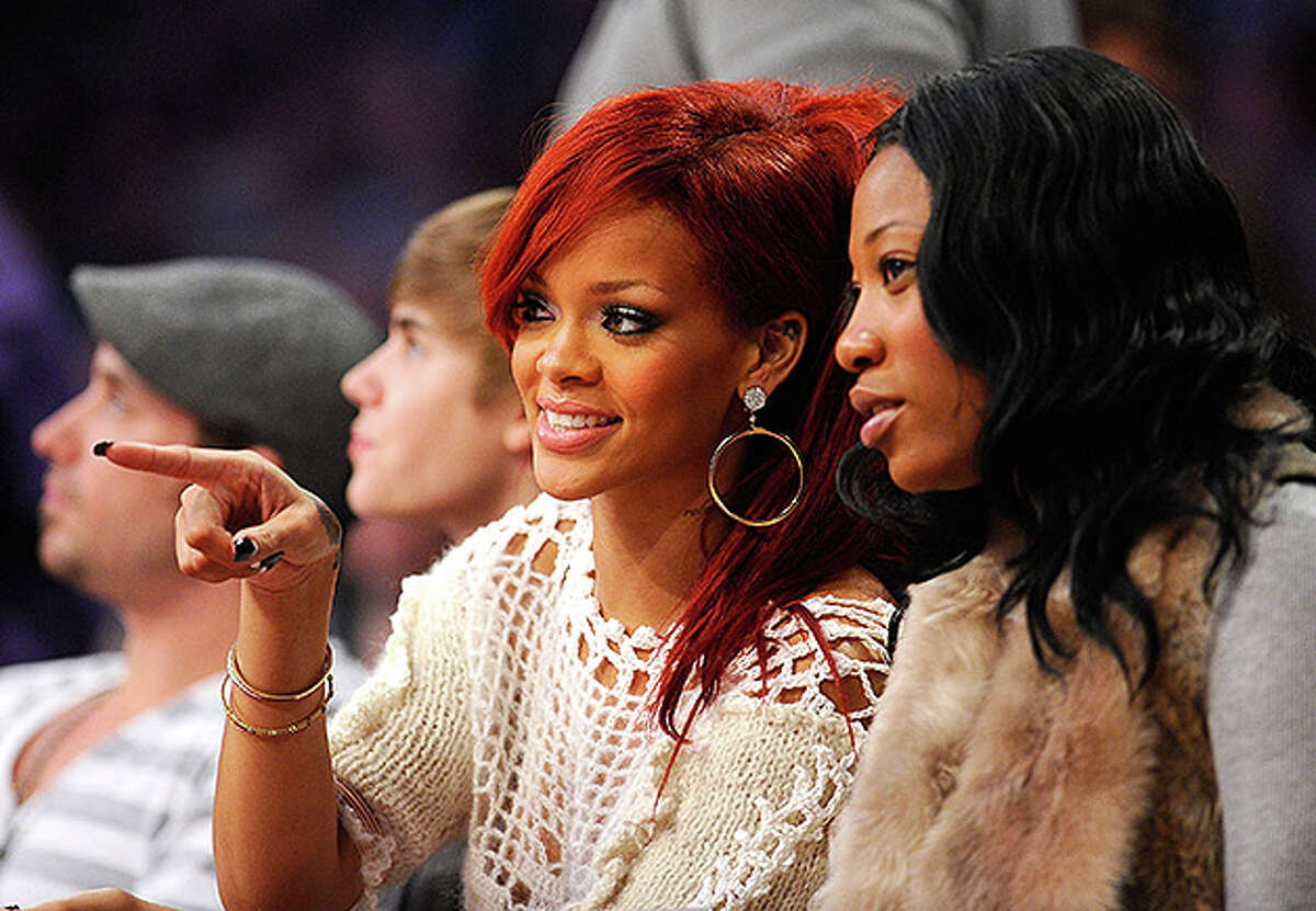 LOS ANGELES, CA - FEBRUARY 20: Singer Rihanna sits in the audience during the 2011 NBA All-Star game at Staples Center on February 20, 2011 in Los Angeles, California. NOTE TO USER: User expressly acknowledges and agrees that, by downloading and or using this photograph, User is consenting to the terms and conditions of the Getty Images License Agreement. (Photo by Kevork Djansezian/Getty Images) *** Local Caption *** Rihanna