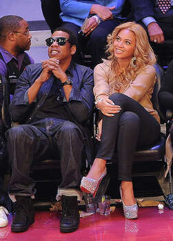 LOS ANGELES, CA - FEBRUARY 20:  Jay-Z (L) and singer Beyonce Knowles during the 2011 NBA All-Star game at Staples Center on February 20, 2011 in Los Angeles, California. NOTE TO USER: User expressly acknowledges and agrees that, by downloading and or using this photograph, User is consenting to the terms and conditions of the Getty Images License Agreement.  (Photo by Jason Merritt/Getty Images) *** Local Caption *** Jay-Z;Beyonce Knowles Photo: Jason Merritt, Getty Images / 2011 Getty Images
