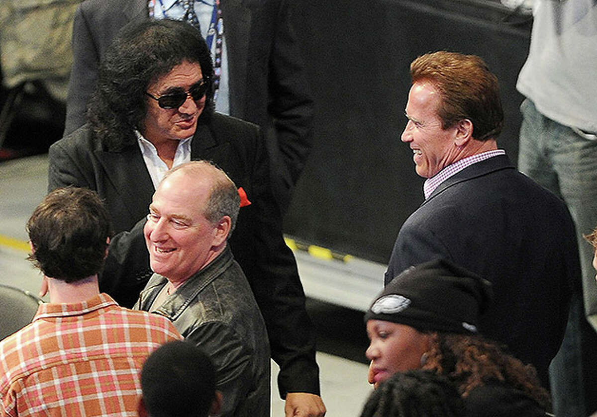 LOS ANGELES, CA - FEBRUARY 20: Musician Gene Simmons (L) and actor Arnold Schwarzenegger (R) in the audience during the 2011 NBA All-Star game at Staples Center on February 20, 2011 in Los Angeles, California. NOTE TO USER: User expressly acknowledges and agrees that, by downloading and or using this photograph, User is consenting to the terms and conditions of the Getty Images License Agreement. (Photo by Jason Merritt/Getty Images) *** Local Caption *** Arnold Schwarzenegger;Gene Simmons