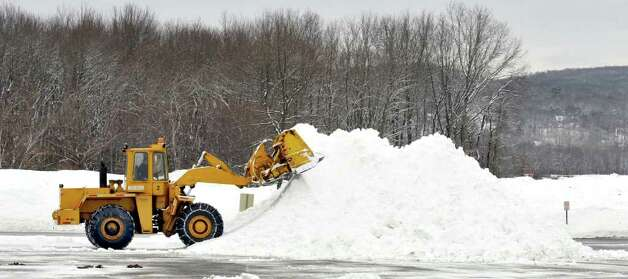 More snow adds to the white mountains already piled in the parking lot of the Danbury Fair mall Monday, Feb. 21, 2011. Photo: Michael Duffy / The News-Times