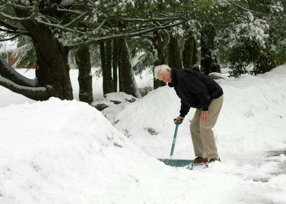 As the snowfall started to wind down, Jim Matyas clears his Burr St. driveway in Fairfield, Conn. on Monday, Feb. 21, 2011.