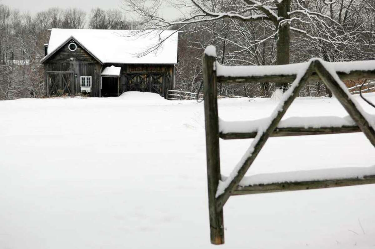 A fresh coat of snow covers a barn on Redding Road in Fairfield, Conn. on Monday, Feb. 21, 2011.