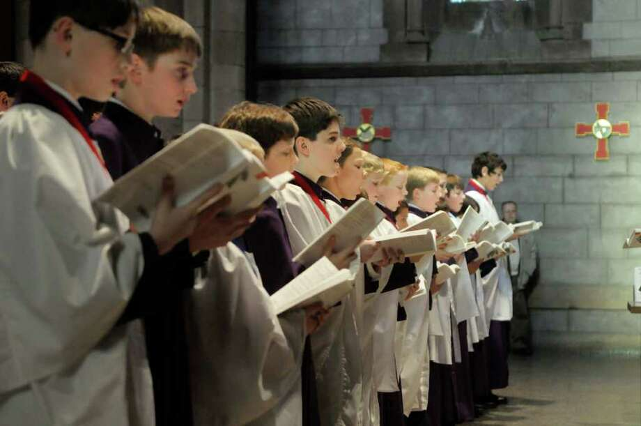 Members of the Cathedral Choir of Men and Boys are shown performing last December at Albany?s Cathedral of All Saints during the Festival of Nine Lessons and Carols. The group left on a 10-day trip to Hereford England Friday to serve as Hereford Cathedral?s house choir. Feb. 20, 2011. (Paul Buckowski/ Times Union) Photo: Paul Buckowski / 00011461A