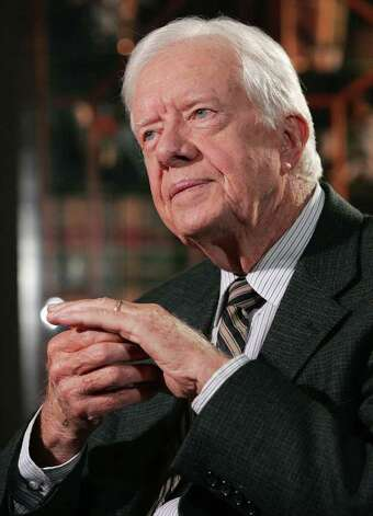 Jimmy Carter — A peanut farmer before he became president, Carter loved to munch on them, too. Not surprisingly, one of his favorite dishes is Southern fried chicken. / AP