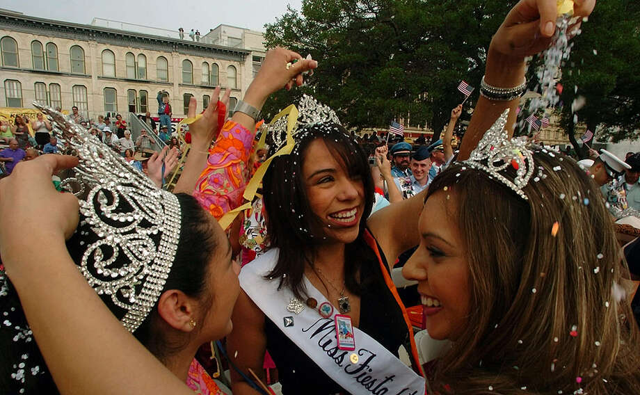 Erica Gonzaba (from left), Vanessa Cobarrubias and Tina Cuellar cascarone each other during Fiesta's opening ceremony in 2005.