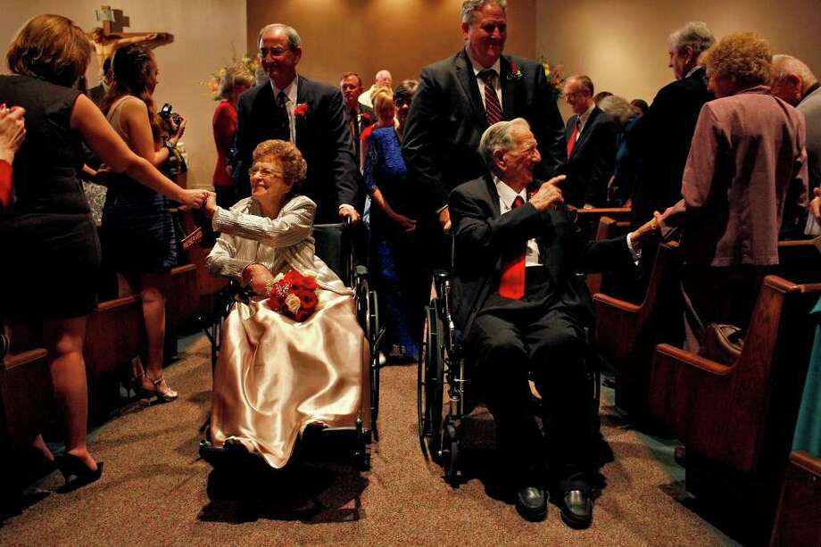 The newlyweds Jewel Etter, 93, and Holman Massey, 92, are congratulated by friends and family at the conclusion of their wedding at Holy Spirit Catholic Church on Saturday, Feb. 19, 2011. Photo: LISA KRANTZ, LISA KRANTZ / Lkrantz@express-news.net / SAN ANTONIO EXPRESS-NEWS