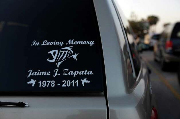 Stickers showing support are seen on vehicles at the wake for slain Immigrations and Customs Enforcement Special Agent Jaime Zapata at the Brownsville Event Center. Photo: JERRY LARA / glara@express-news.net