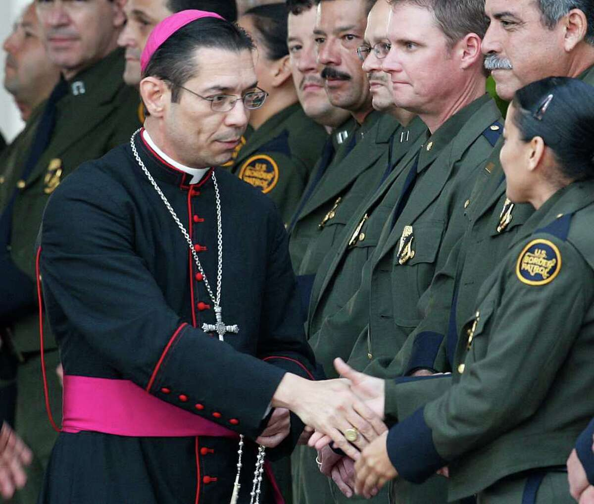 Diocese of Brownsville Bishop Daniel E. Flores arrives for the wake of slain Immigrations and Customs Enforcement Special Agent Jaime Zapata at the Brownsville Event Center on Feb. 21.
