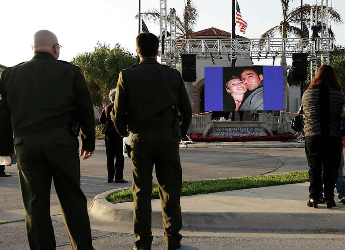 Family, friends and supporters watch a music slide show of Immigrations and Customs Enforcement Special Agent Jaime Zapata as they arrive for a wake at the Brownsville Event Center in Brownsville on Feb. 21, 2011. Zapata was killed last week in Mexico and no arrests have been made in the zttack.