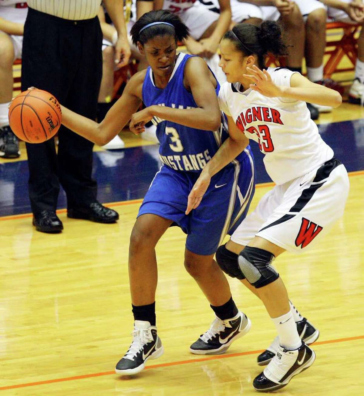 Jay's Aleeya Harris looks for room around Wagner's Arielle Roberson during the first half on Monday, Feb. 21, 2011, at the UTSA Convocation Center.