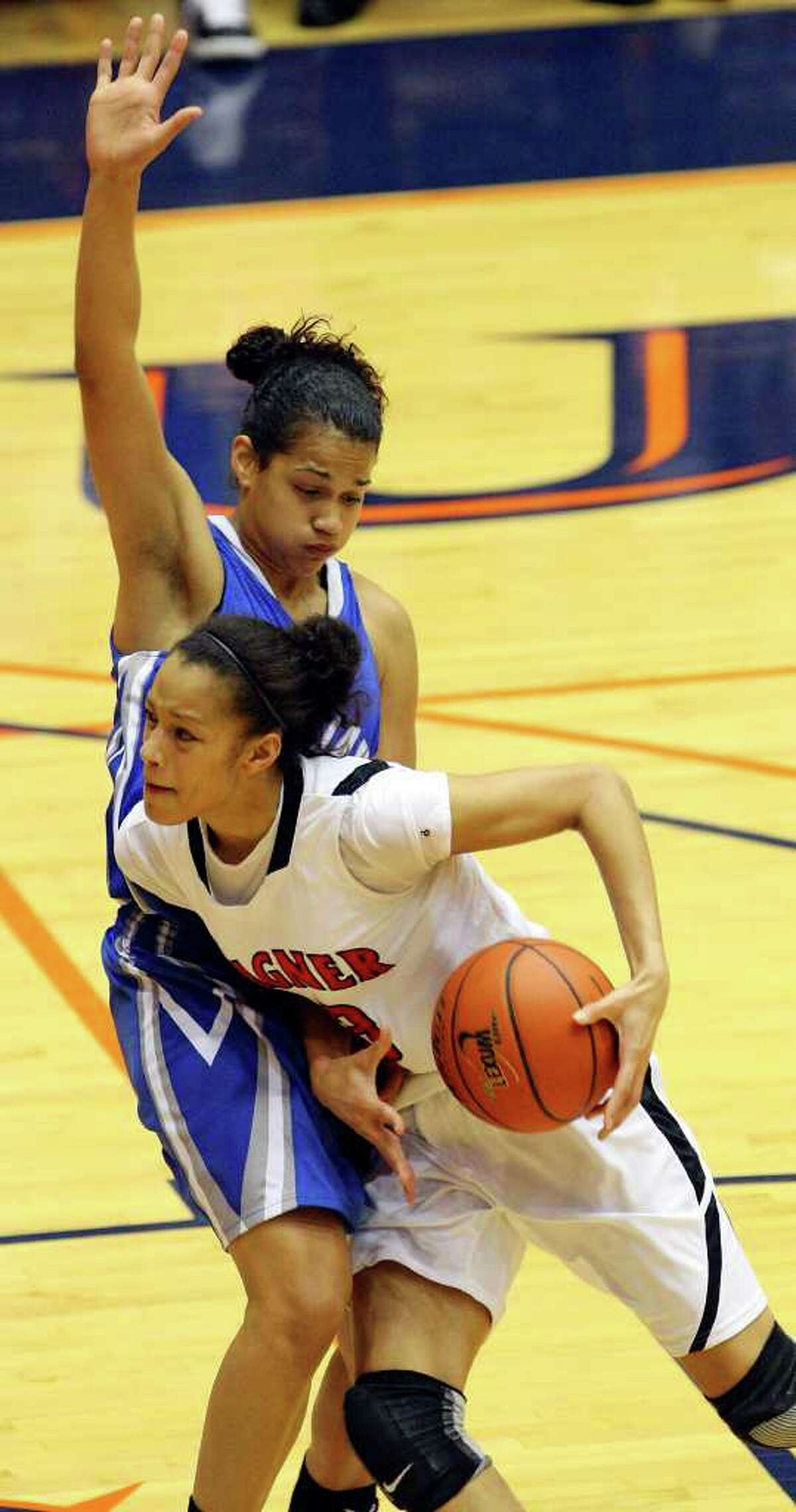 Wagner's Arielle Roberson looks for room around Jay's Erica Donovan during the first half on Monday, Feb. 21, 2011, at the UTSA Convocation Center.