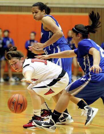 Wagner's Corrina Moncada grabs for a loose ball between Jay's Erica Donovan (rear) and Destiny Amezquita during the second half on Monday, Feb. 21, 2011, at the UTSA Convocation Center. Wagner won 54-41. Photo: EDWARD A. ORNELAS, Edward A. Ornelas/Express-News / eaornelas@express-news.net