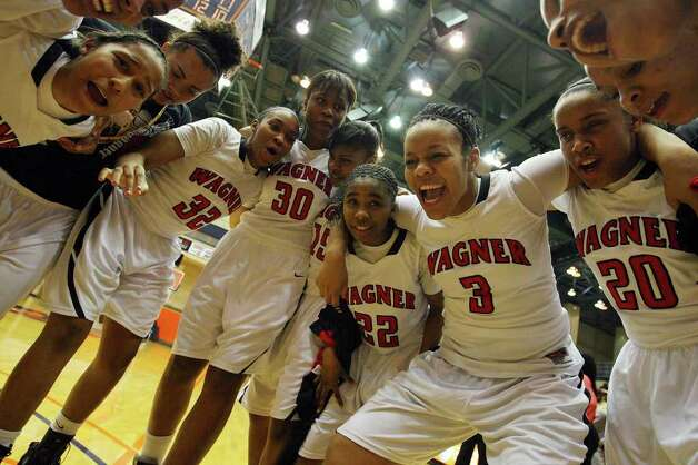 Members of the Wagner Lady T-Birds celebrate their 54-41 win over Jay, Monday Feb. 21, 2011, at the UTSA Convocation Center. Photo: EDWARD A. ORNELAS, Edward A. Ornelas/Express-News / eaornelas@express-news.net