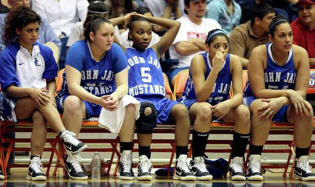 Members of the John Jay Lady Mustangs sit dejected on the bench late in the game with Wagner on Monday, Feb. 21, 2011, at the UTSA Convocation Center. Wagner won 54-41. Photo: EDWARD A. ORNELAS, Edward A. Ornelas/Express-News / eaornelas@express-news.net