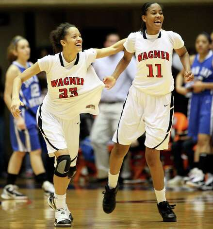 Wagner's Arielle Roberson (left) and Eboni Watkins celebrate their 54-41 win over Jay on Monday, Feb. 21, 2011, at the UTSA Convocation Center. Photo: EDWARD A. ORNELAS, Edward A. Ornelas/Express-News / eaornelas@express-news.net