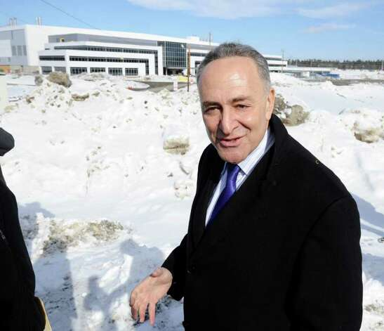 Senator Charles Schumer stands in front of the Chip Fab Plant at Global Foundries in Malta, New York February 21, 201.  Schumer was there to enlightened about a new administration building that is slated to be constructed at the Tech Park adjacent to the present construction of the $4.6 million Chip Fab Plant which will bring more jobs to the area.   (Skip Dickstein / Times Union) Photo: SKIP DICKSTEIN / 00012149A