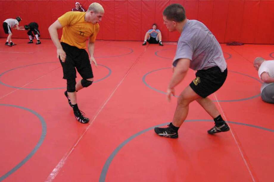 Joe Shell of Colonie, left, and Nick Gwiazdowski of Duanesburg, right, pair off during a Section II group wrestling practice at Niskayuna High School Monday morning Feb. 21 2011. Wrestlers prepared for the state championships held this weekend. (Will Waldron / Times Union) Photo: Will Waldron