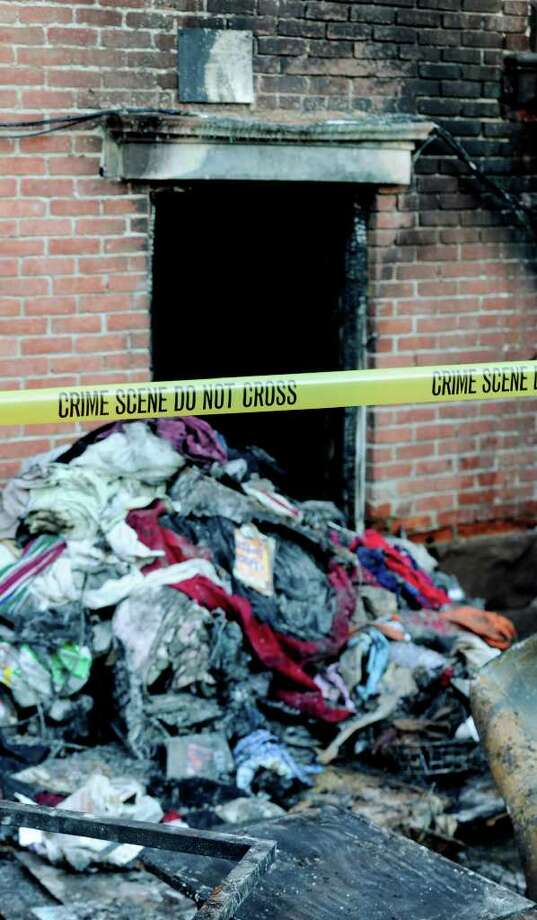 Personal belongings and charred furniture are all that remains of the interior of 69 Grand Street in Albany, New York February 22, 2011 after a fire gutted the building and caused the death of one of the occupants.   (Skip Dickstein / Times Union) Photo: Skip Dickstein