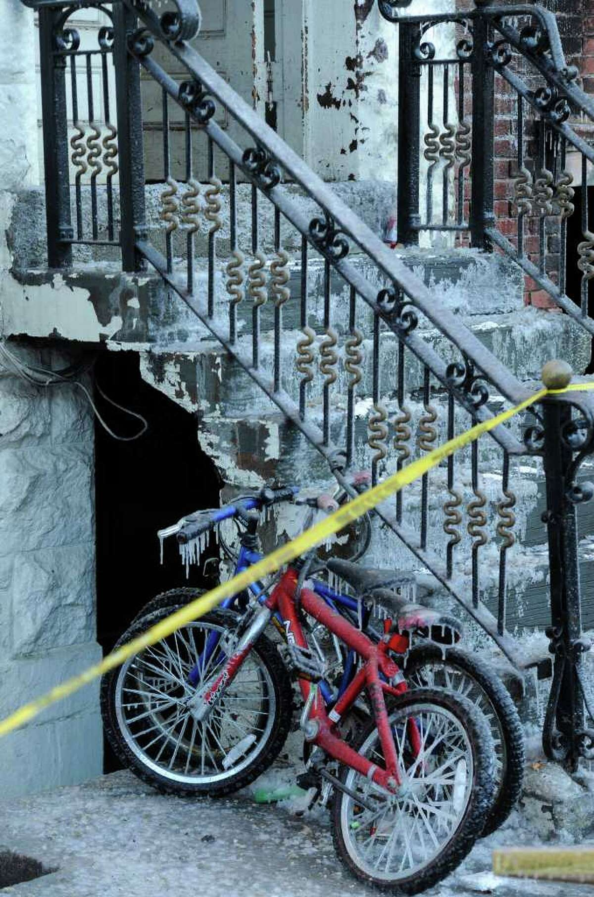 Bicycles parked outside 71 Grand Street are covered with ice after a fire spread from 69 Grand Street and was the cause of a death in Albany, New York February 22, 2011. (Skip Dickstein / Times Union)