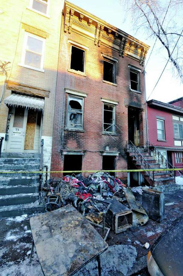 All is quiet at 69 Grand Street in Albany, New York February 22, 2011 after a serious fire gutted the house last evening and may have caused a death of one of the residents at the address.   (Skip Dickstein / Times Union) Photo: Skip Dickstein