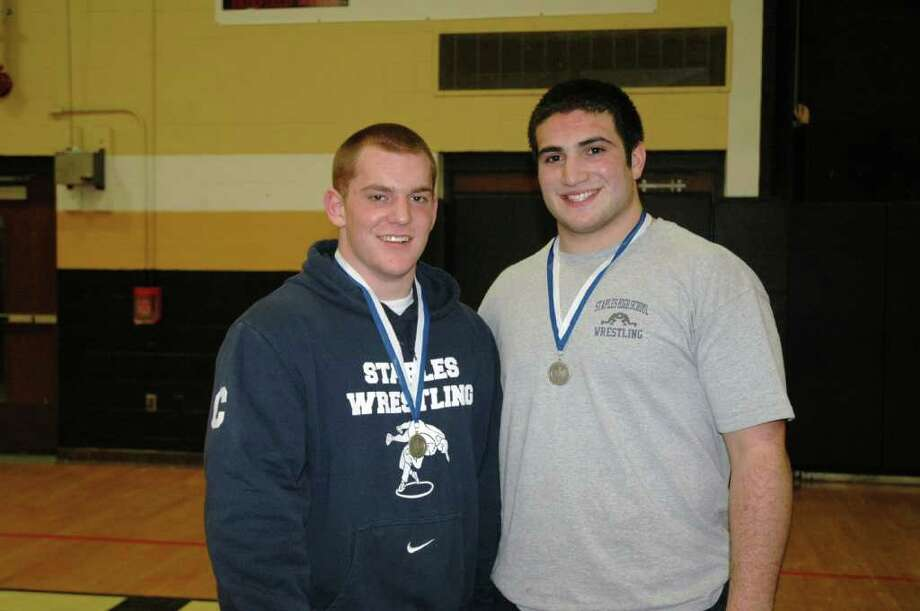 Staples senior quad-captains Chris Giunta and Julian Gendels display their silver medals with pride after placing second in the 215-pound and heavyweight weight classes, respectively in the Class LL wrestling championships. Giunta and Gendels led the Wreckers to 14th place overall with 68.5 points. Photo: Contributed Photo / Rick Giunta