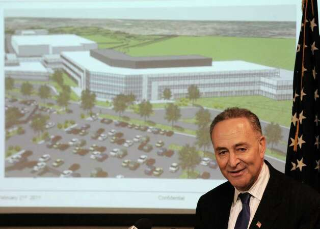Senator Charles Schumer speaks during a press conference at Global Foundries in Malta, New York February 21, 2011about a new administration building (shown in background) that is slated to be constructed on at the Tech Park adjacent to the present construction of the $4.6 million Chip Fab Plant.   (Skip Dickstein / Times Union) Photo: SKIP DICKSTEIN / 00012149A