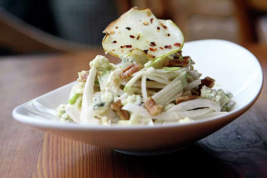 Endive, Apple, and Gorgonzola Dolce Salad is a popular creation by executive chef Gabriel Ibarra at Cappy's. Photo: HELEN L. MONTOYA, SAN ANTONIO EXPRESS-NEWS / hmontoya@express-news.net