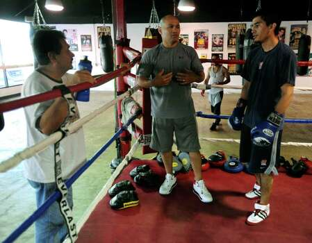 """Jesse"" James Leija, middle, speaks with Adam Lopez, 19, right, and his father, Robert Lopez, left, at ChampionFit Gym on Friday, Sept. 24, 2010. The younger Lopez hopes to make the U.S. National Boxing team for the 2012 Olympics in London.  BILLY CALZADA / gcalzada@express-news.net Photo: BILLY CALZADA, SAN ANTONIO EXPRESS-NEWS / gcalzada@express-news.net"