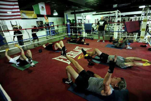 "Many professionals work out at ""Jesse"" James Leija's ChampionFit Gym. Wednesday, July 7, 2010. Leija is a former boxing champion. BILLY CALZADA / gcalzada@express-news.net  john whisler story Photo: BILLY CALZADA, SAN ANTONIO EXPRESS-NEWS / gcalzada@express-news.net"