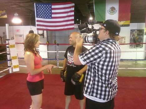 "Cynthia Lee shoots a video segment with boxer ""Jesse"" James Leija. She hopes the video leads to a show that will be produced by Oprah Winfrey. Photo: Courtesy Cynthia Lee"